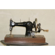 Jones  (about 1900) Sewing machine on fixed tableau
