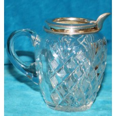 Crystal with silver (20ᵉ century) Cream jug with ear and a silver rim and spout
