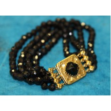 Gold and beads (20ᵉ century) Bracelet with gold lock with stone and black beads in three rows