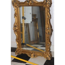 Plastic (19ᵉ century) Mirror in a gilded ornaments frame