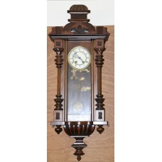 Hollands Wood (20ᵉ century) Wall clock with wooden decorations with percussion of half and whole hours